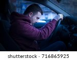 man driving car and falling... | Shutterstock . vector #716865925
