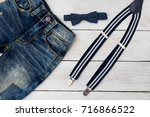 suspenders and bow tie on... | Shutterstock . vector #716866522