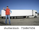 mature truck driver with thumb... | Shutterstock . vector #716867656