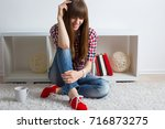 beautiful young woman in modern ... | Shutterstock . vector #716873275