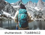 woman with backpack hiking in... | Shutterstock . vector #716884612