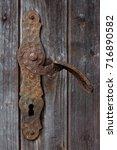 close up of the old rusty door...   Shutterstock . vector #716890582