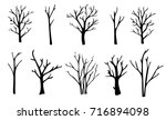 Stock vector naked trees silhouettes set hand drawn isolated illustrations 716894098