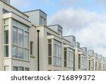 modern apartment building in... | Shutterstock . vector #716899372