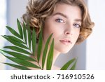 beautiful young woman with... | Shutterstock . vector #716910526