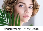 beautiful young woman with... | Shutterstock . vector #716910538