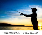 young man fishing on a river... | Shutterstock . vector #716916262