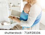 close up of young mom reading... | Shutterstock . vector #716928106