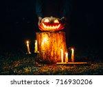 spooky smiling halloween... | Shutterstock . vector #716930206