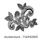 doodle floral pattern in black... | Shutterstock .eps vector #716942005