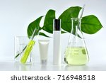 cosmetic bottle containers with ... | Shutterstock . vector #716948518