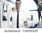 portrait of cheerful male... | Shutterstock . vector #716949235