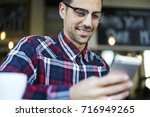 smiling young hipster guy in... | Shutterstock . vector #716949265