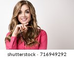 young businesswoman holding... | Shutterstock . vector #716949292