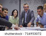 group of marketing experts... | Shutterstock . vector #716953072