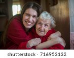 an elderly woman in an embrace... | Shutterstock . vector #716953132