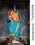 stone statue in brihadeeswarar... | Shutterstock . vector #716959696