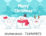 tooth with merry christmas on... | Shutterstock .eps vector #716969872