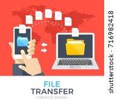 file transfer. hand holding... | Shutterstock .eps vector #716982418