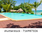 luxury swimming pool at the... | Shutterstock . vector #716987326