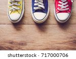 multi color sneakers on wood... | Shutterstock . vector #717000706