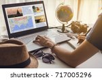 young women planning vacation... | Shutterstock . vector #717005296