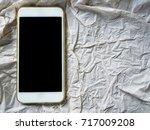 smart phone on paper | Shutterstock . vector #717009208
