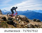 mountain biking in whistler ... | Shutterstock . vector #717017512