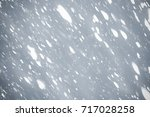 snowflakes  and bokeh or... | Shutterstock . vector #717028258