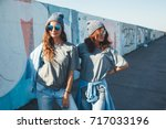 two models wearing plain gray t ... | Shutterstock . vector #717033196