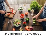 married couple cooking together ... | Shutterstock . vector #717038986