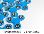 group of blue fidget spinners... | Shutterstock . vector #717043852