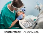 male dentist with dental tools  ... | Shutterstock . vector #717047326