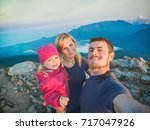family hikers making selfie on... | Shutterstock . vector #717047926