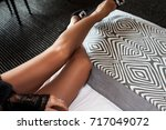 woman resting on a couch at... | Shutterstock . vector #717049072