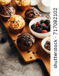 muffins with chocolate and...   Shutterstock . vector #717082102
