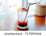 fruit cocktail glass at cafe ... | Shutterstock . vector #717092446