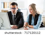 business people working with... | Shutterstock . vector #717120112