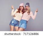 young woman having fun crazy... | Shutterstock . vector #717126886