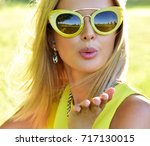 outdoor fashion portrait of... | Shutterstock . vector #717130015