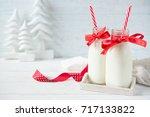 festive bottles of milk with... | Shutterstock . vector #717133822