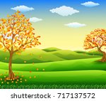 autumn tree with falling leaves | Shutterstock . vector #717137572