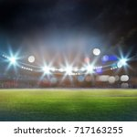 stadium in lights and flashes... | Shutterstock . vector #717163255