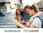 tourist friends discovering... | Shutterstock . vector #717168688