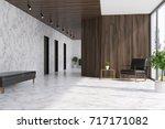 white marble and dark wooden...   Shutterstock . vector #717171082