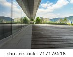 empty wooden footpath front...   Shutterstock . vector #717176518