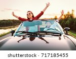 traveling by car   happy couple ... | Shutterstock . vector #717185455
