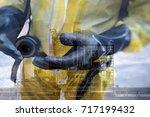 double exposure of  rescuers in ... | Shutterstock . vector #717199432