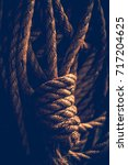 dark closeup photo of a rope... | Shutterstock . vector #717204625