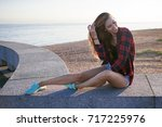 beautiful laughing young girl.... | Shutterstock . vector #717225976